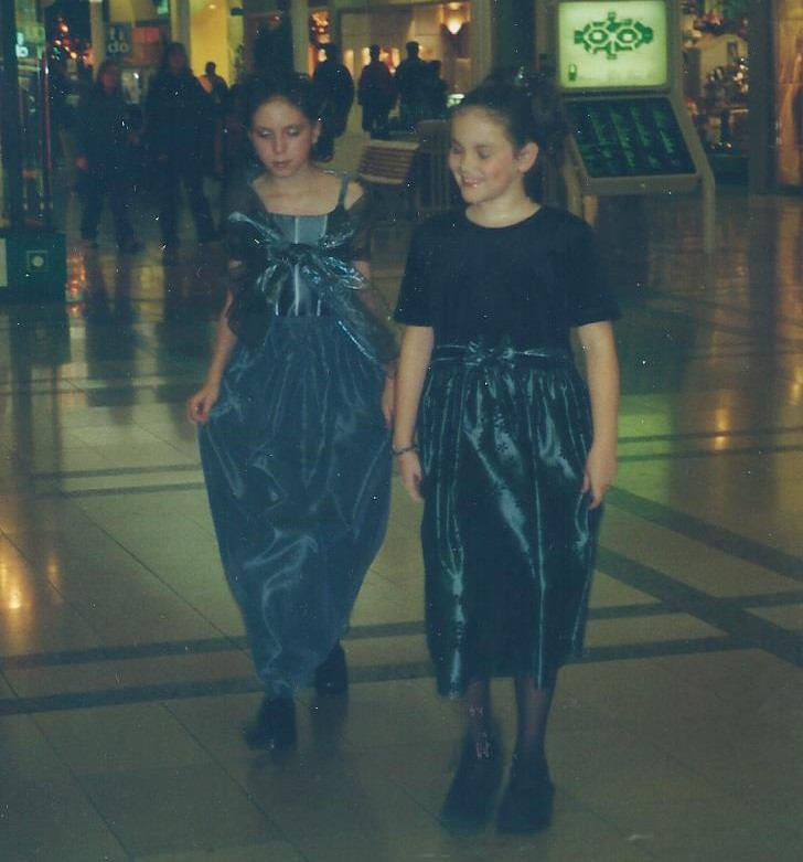 Young Aileen strutting down the catwalk in a fashion show.