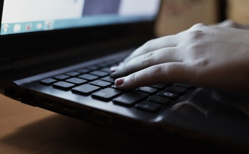 Hands at Laptop typing