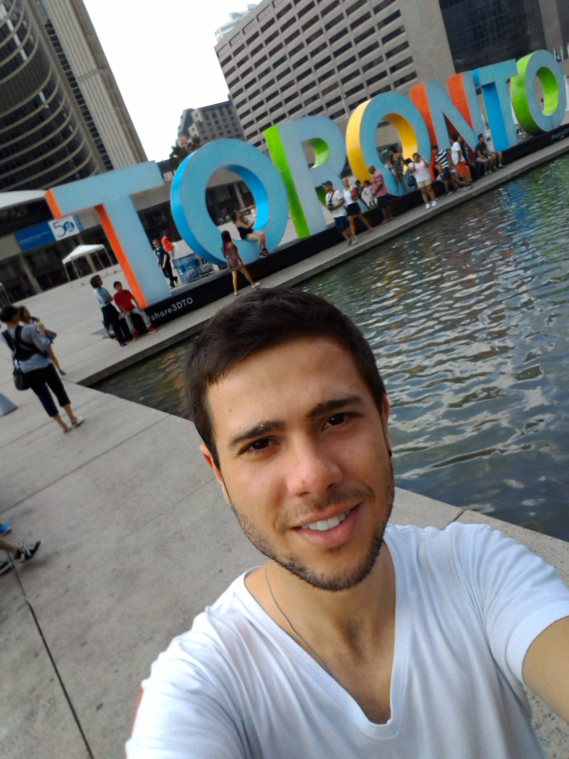Luis at the Toronto sign at Nathan Phillips' Square