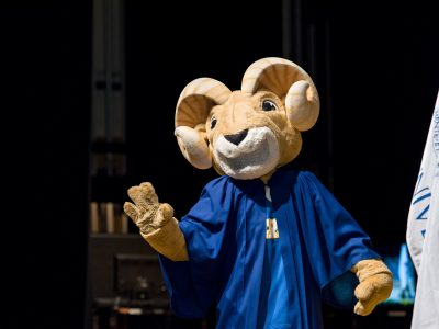 Eggy the ram mascot in graduation gown