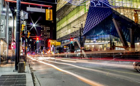 A nighttime shot of the SLC and Yonge Street with the lights streaking