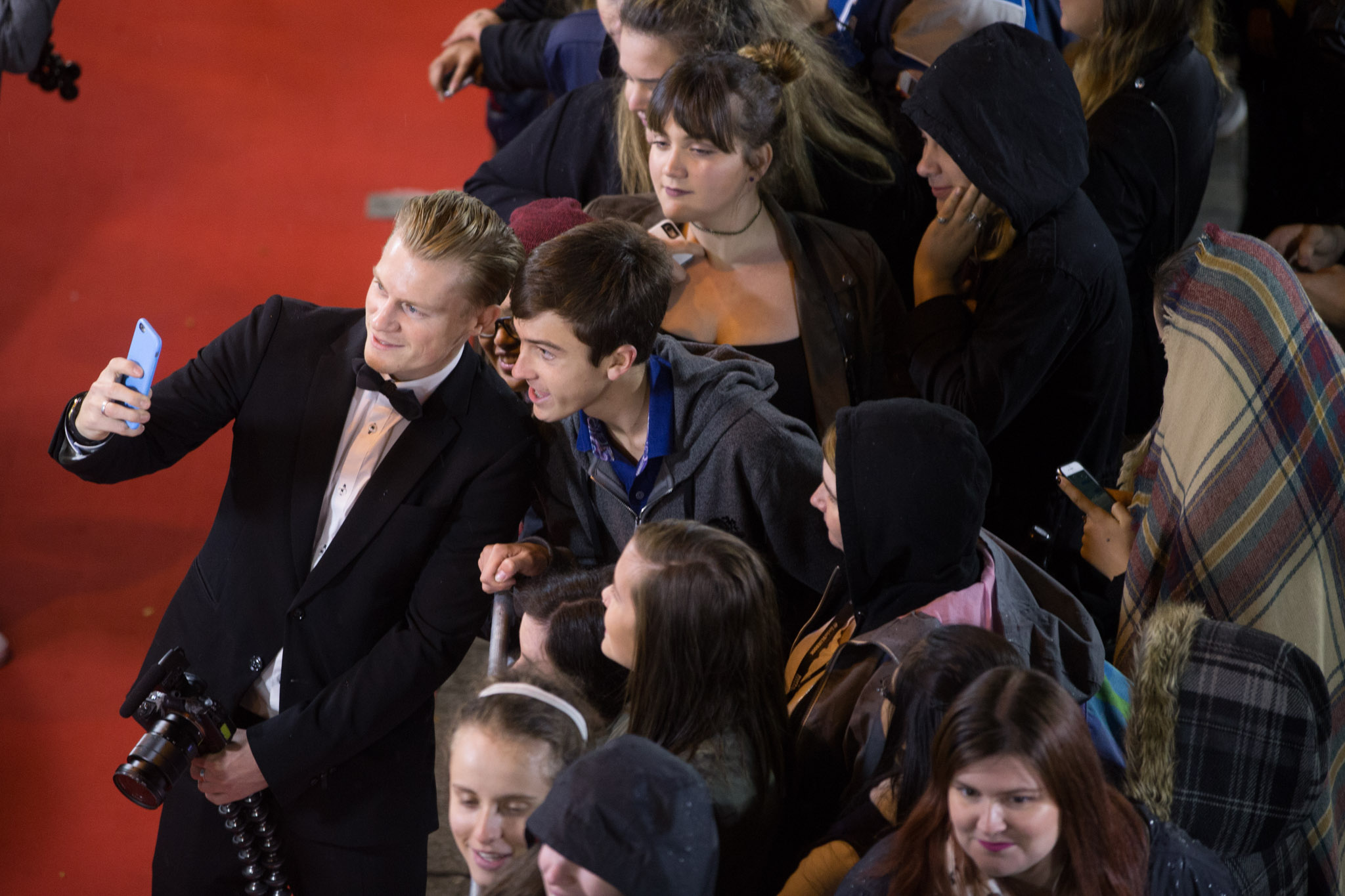 A crowd takes a selfie on the Red Carpet