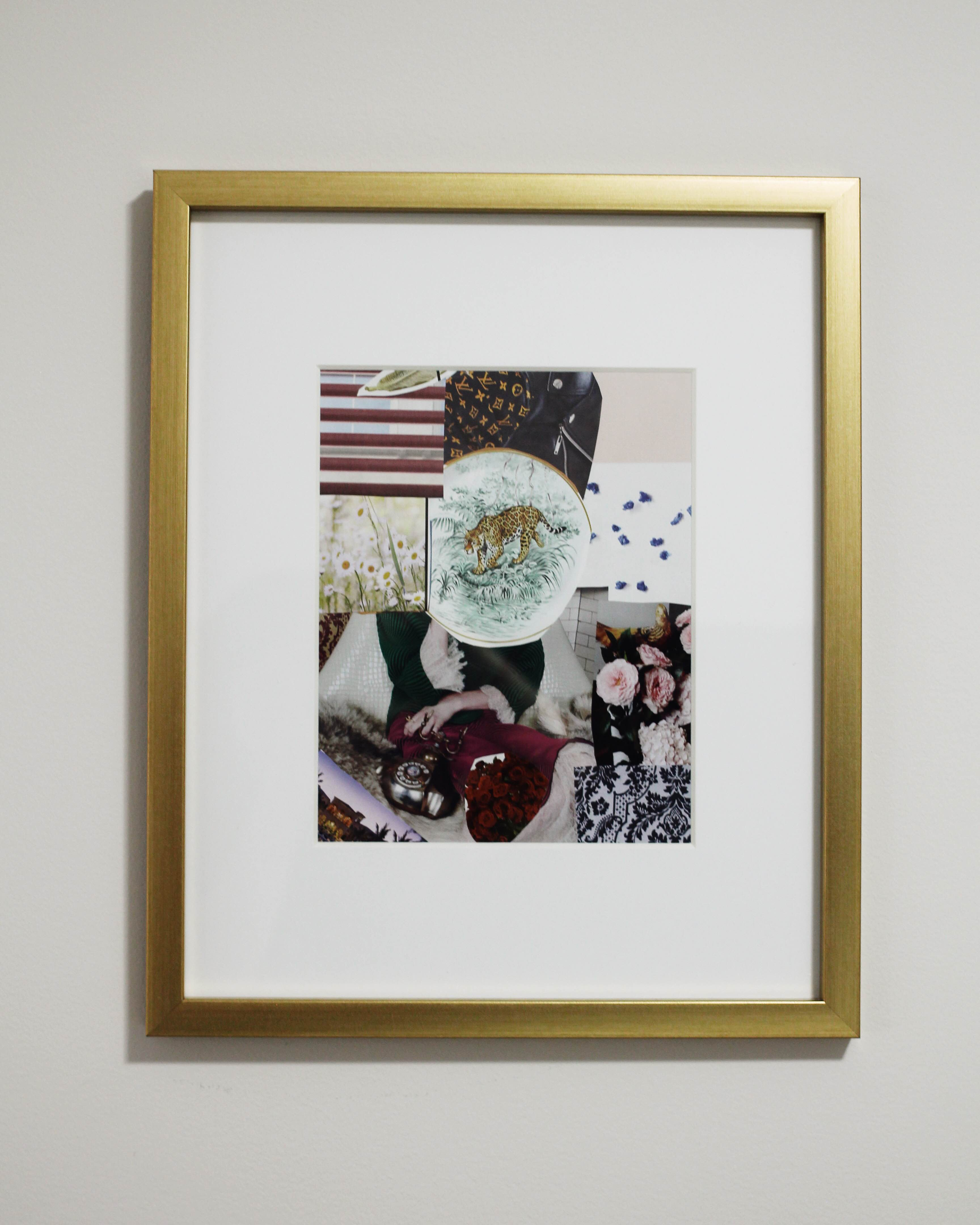 A gold framed photo collage of plants, a painting of a lion, a designer bag and petals on a white wall