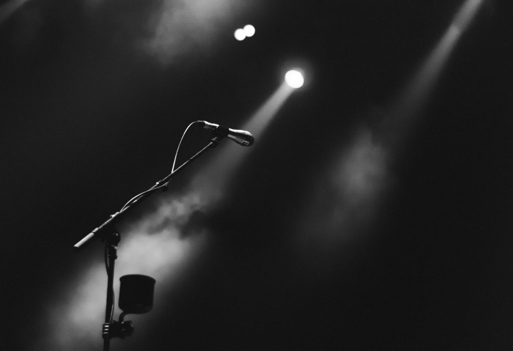 A line microphone on a dark stage