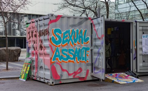 """spray paint of the words """"sexual assault"""" on the side of the Lost Words live artshow exhibit"""