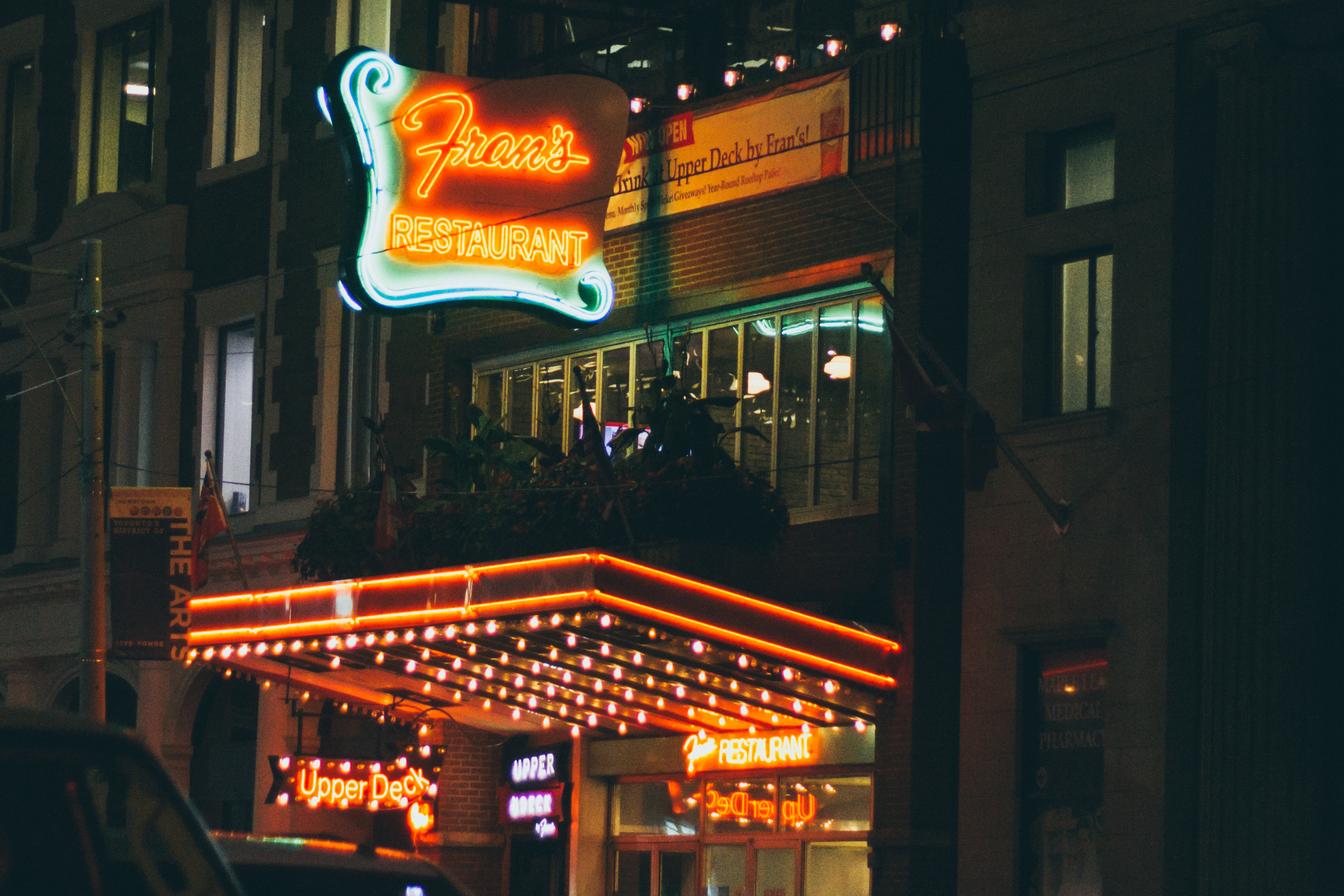 The Fran's Restaurant sign lit up at night