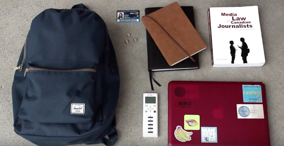 A shot from above of several student items laid out: backpack, laptop, textbook, tokens, iclicker, journal, onecard