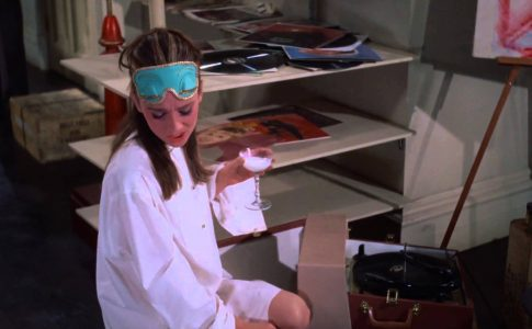 A screenshot of Holly Golightly from Breakfast at Tiffanys