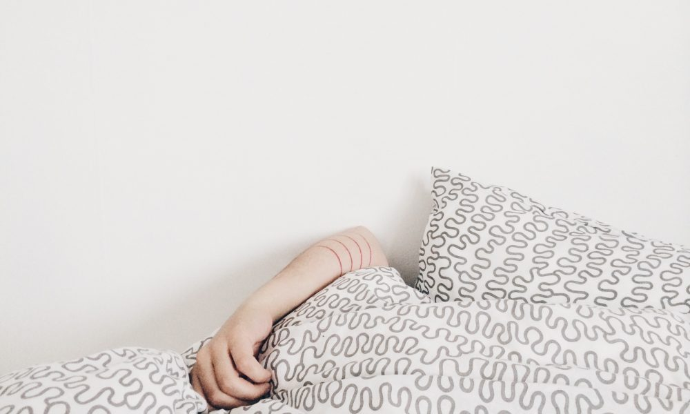 Person sleeps buried under covers
