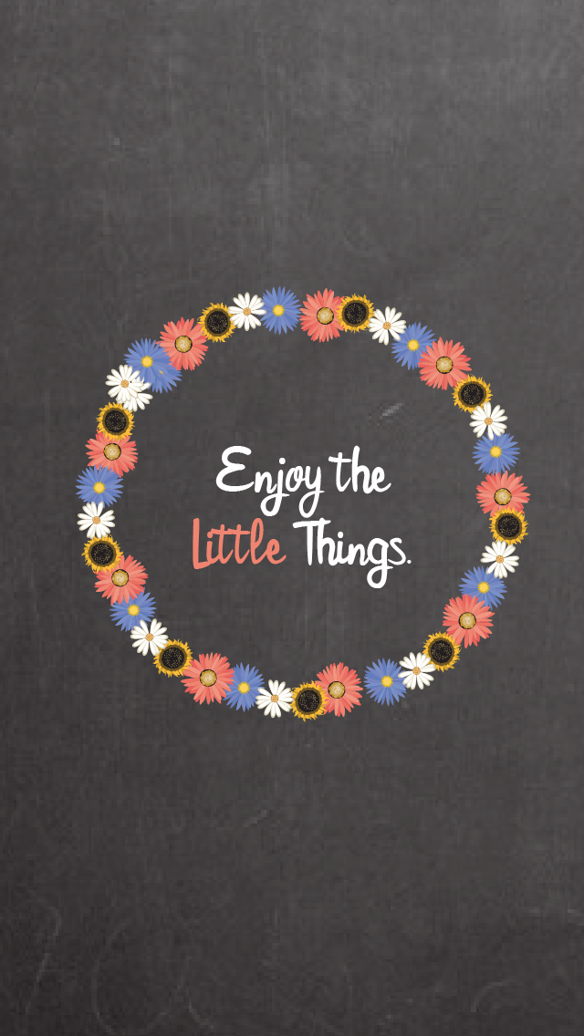 "A circle of flowers and the text inside reading ""Enjoy the little things"""