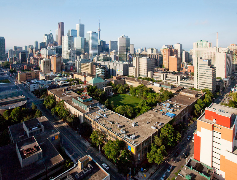Aerial view of the Quad in summer with the Toronto skyline and cityscape in the background.