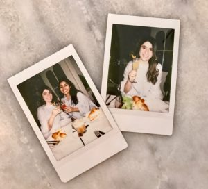 Polaroid pictures of Janine and Serena celebrating her birthday