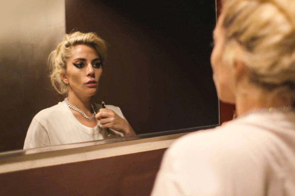 side angle of Lady Gaga looking at herself in the mirror from her documentary Five Foot Two