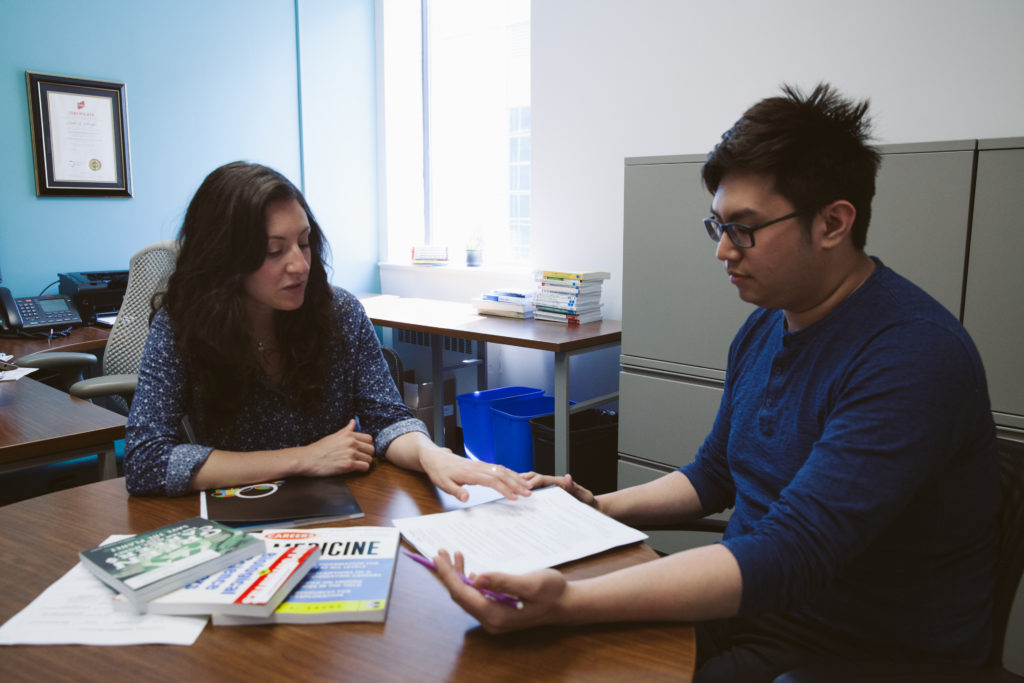 A student meets with a career advisor in their office.