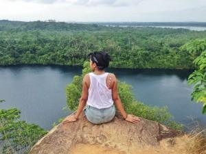 Jasmin sitting on rock overlooking hills