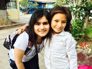 Photo of Zahra with child in Honduras