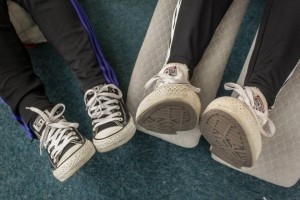 Photo of two people's pairs of shoes