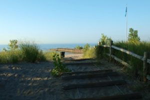 A photo of the sand and boardwalk leading to Lake Ontario