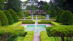 A photo of the manicured gardens and fountain in High Park