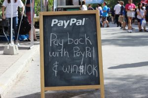 """A chalkboard sign that says """"PayPal: Pay back with Paypal and win $10K!"""