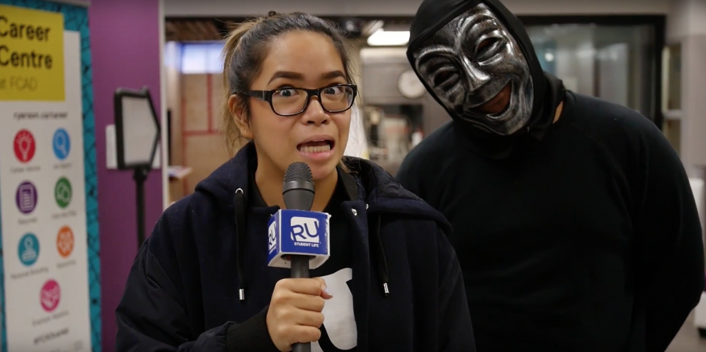 Someone in a mask creeps up behind Jillian for a scare!