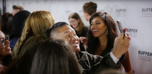 A group of fans take a selfie with a Youtube creator at Buffer Festiva