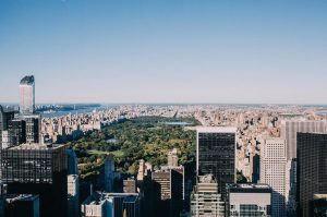 a wide cityscape shot of Central Park and skyscrapers in NYC from the top of the Rockefeller Center