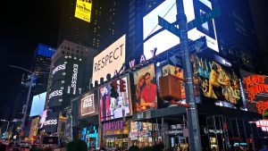 times square at night with billboards of respect, forever 21, express, star wars, planet hollywood