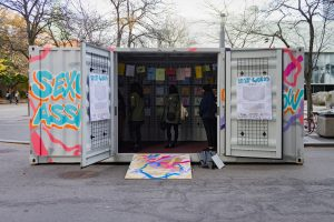 wide shot of the lost words roadshow exhibit on campus with artwork and a few people inside