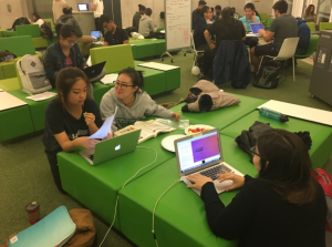 A group of students study together on the SLC Fourth Floor in SLS