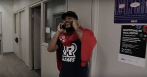 Musa from RU Leadership talks on the phone