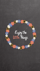 """A circle of flowers and the text inside reading """"Enjoy the little things"""""""