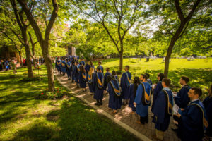 A line of graduands in the Quad in their robes