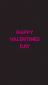 """A black background and pink text saying """"Happy Valentine's Day"""""""