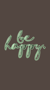 """A brown background with script that says """"be happy"""""""