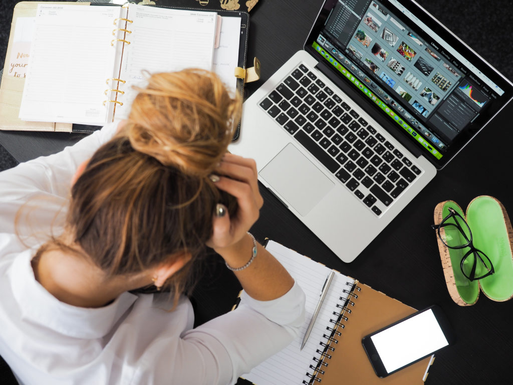 photo of girl stressed out over work