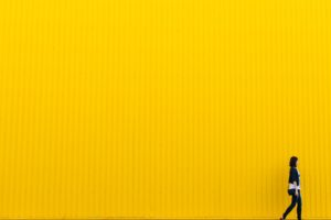 woman against a yellow wall